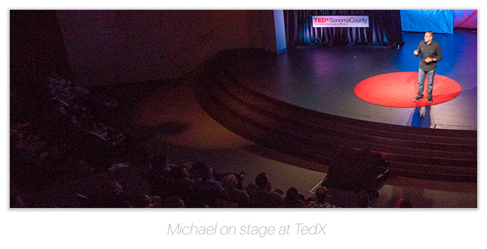 Michael Brito on stage at TedX